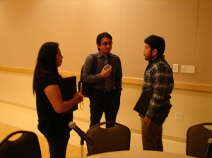 Stephanie Rodriguez (left) and Narciso Jimenez (right) talk with fellow students about internships